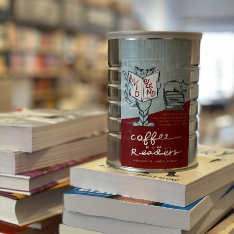 Jittery Joe's Avid Blend Coffee on a stack of books