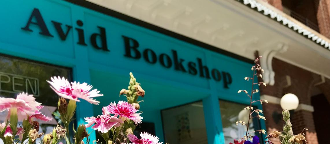 flowers with Avid Bookshop blue shopfront in background