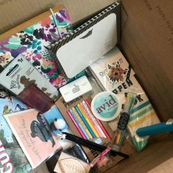 Avid Bookshop Gift Boxes, interior of a box with stickers, pens, paper, and cards